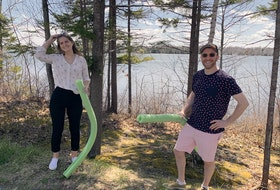 Jessica Urquhart and Dave Wolpin on the shore of First Lake in Lower Sackville, where Wolpin and partner Jon Rasenberg will this summer operate Splashifax, a floating playground and obstacle course.