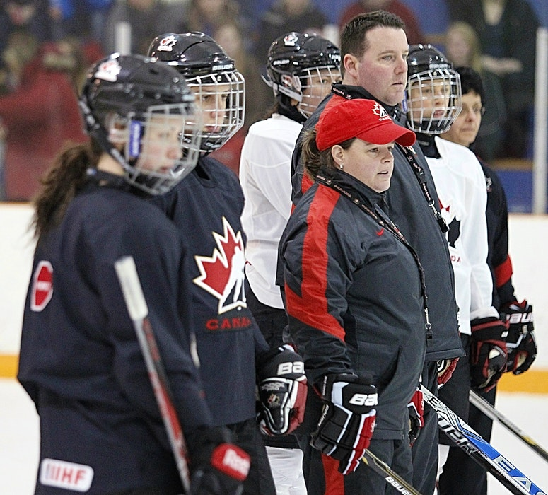 Lisa Haley, middle, shown during her tenure with Hockey Canada, was named the head coach of the Hungarian women's hockey team last summer. - PostMedia