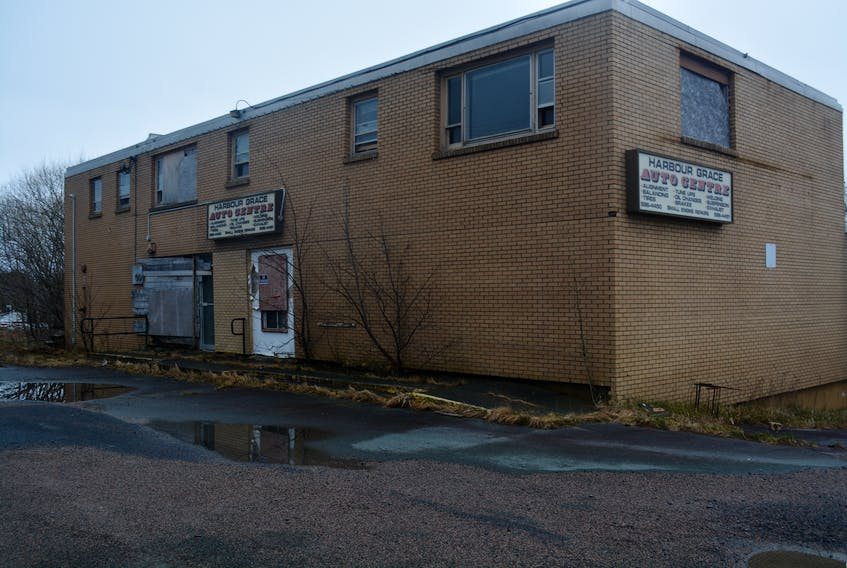 The old Canadian Tire building in Harbour Grace is starting to fall apart and the town is working with the owner to get it taken down.