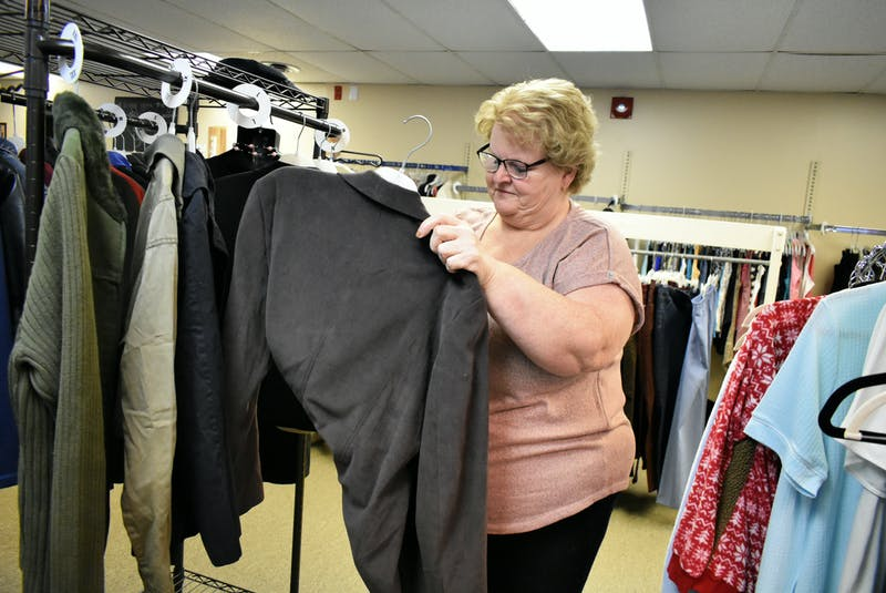 """Belinda Woods sorting through the clothes, some new, others preloved, at the Free Store in Summerside, PEI. """"People can put you in a box and make you feel like you will never amount to anything. But it is OK to say, 'I want something better,' and strive for it. Never underestimate your abilities,"""" states Woods. - Desiree Anstey"""