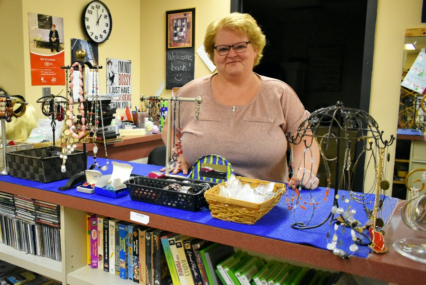 Belinda Woods at the Free Store in Summerside, PEI. After growing up in an abusive home in Cape Breton, Woods has found a way to heal by helping others.