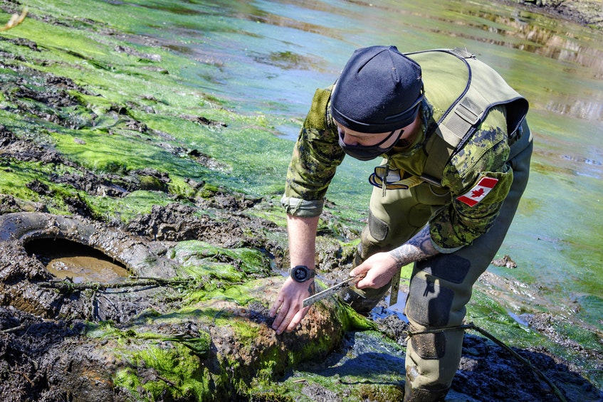 Members of the Maritime Explosive Ordnance Disposal (MEOD) Team from Fleet Diving Unit (Atlantic) have been working in and around a pond in Chebogue, Yarmouth County, to remove a 500-lb UXO from the Second World War. PHOTO: Master Corporal Ian Thompson, Canadian Armed Forces