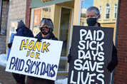 Protesters in Ontario call for paid sick leave earlier this year.