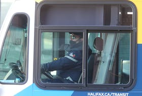 FOR LOCKDOWN STORIES: A Metro Transit driver wheels their bus on Barrington Street on the first day of a province-wide lockdown in Halifax Wednesday April 28, 2021.  TIM KROCHAK PHOTO