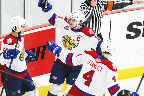 Edmonton Oil Kings captain Scott Atkinson celebrates a goal with Dylan Guenther (11) and Ross Stanley  (4) against the Calgary Hitmen at Seven Chiefs Sportsplex on March 27, 2021, in Calgary.