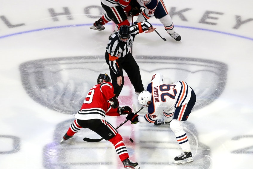 onathan Toews (19) of the Chicago Blackhawks and Leon Draisaitl (29) of the Edmonton Oilers face off in Game 4 of the Western Conference qualification round prior to the 2020 NHL Stanley Cup Playoffs at Rogers Place on August 07, 2020, in Edmonton.