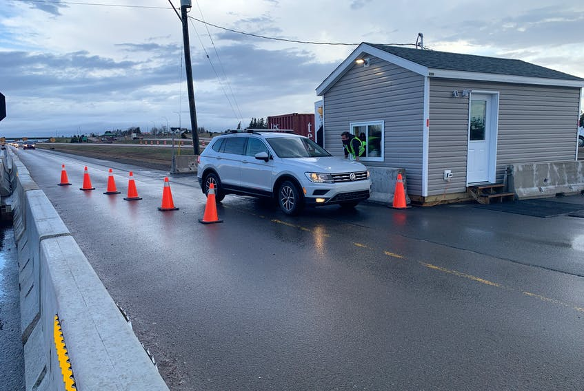 A border liaison officer speaks to a motorist coming into Nova Scotia at the border checkpoint at Fort Lawrence. Business owners on both sides of the border are concerned with new rules the New Brunswick government put in place last week for those who cross the border to work in Nova Scotia.