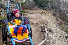 Five-year-old Lyndon Andersen was all smiles earlier this month during a hike with his brother, Zander, and their mother, Adina Stamp, at LaManche trail. The specialized Hippocampe wheelchair the family borrowed from the Janeway children's hospital enables Lyndon to enjoy places with all kinds of surfaces and rough terrain.