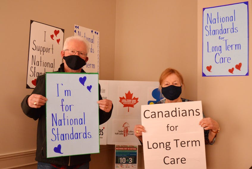 Leo Broderick, left, who is with the Council for Canadians, and Mary Boyd, who is with the P.E.I. Health Coalition, stand in support of national standards for long-term care homes. They attended a virtual rally on April 27.