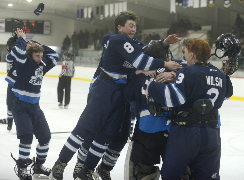 The Eastern Express rushed to goalie Jackson MacDonald after the final buzzer sounded Friday at the O'Leary Community Sports Centre. - Jason Malloy • The Guardian