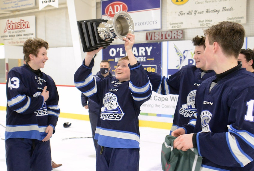 Mason Power lifts the championship trophy Friday after the Eastern Express won the P.E.I. Major Under-15 AAA Hockey League title. - Jason Malloy • The Guardian