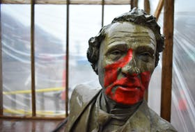 The Sir John A. Macdonald bench statue at the corner of Queen Street and Victoria Row in Charlottetown was subject to vandalism sometime late Thursday, April, 29 or in the early morning hours of Friday, April 30. A public works crew was at the site on Friday, April 28 sandblasting the paint off.