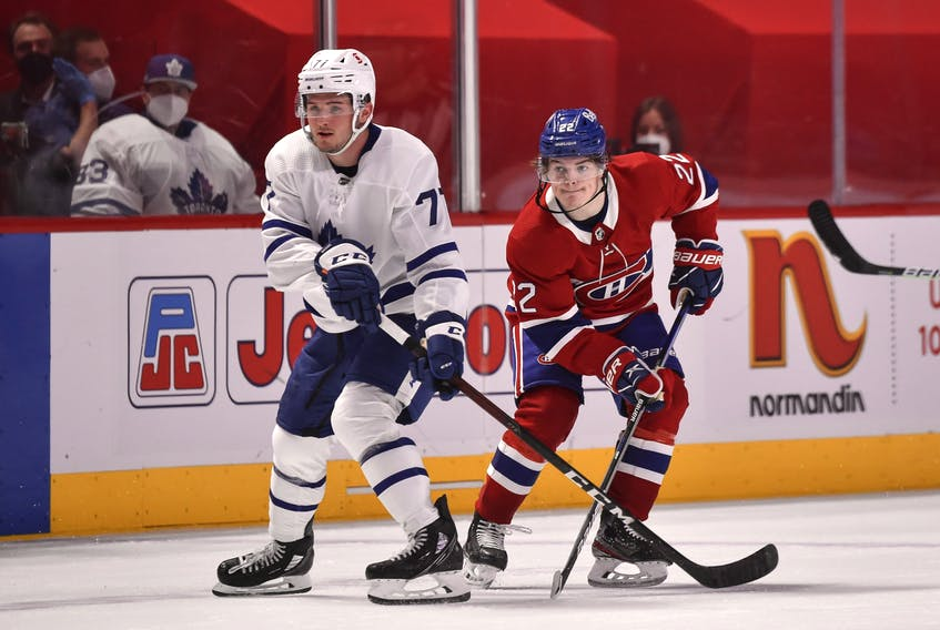 Maple Leafs' Adam Brooks and Cole Caufield of the Canadiens watch over the play on Wednesday, April 28, 2021 in Montreal. Minas Panagiotakis/Getty Images