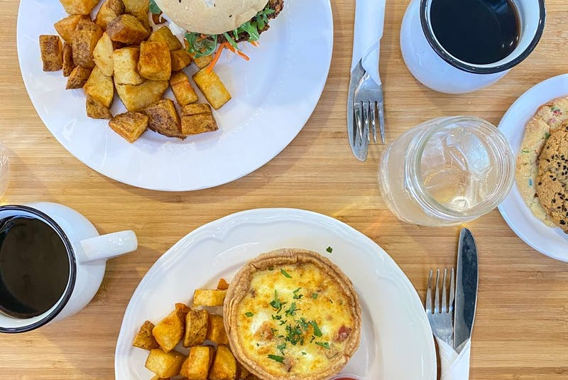 The breakfast menu at The Grounds Cafe is dominated by egg dishes like quiche and biscuit breakfast sandwiches, with lots of crispy potatoes.  - Gabby Peyton