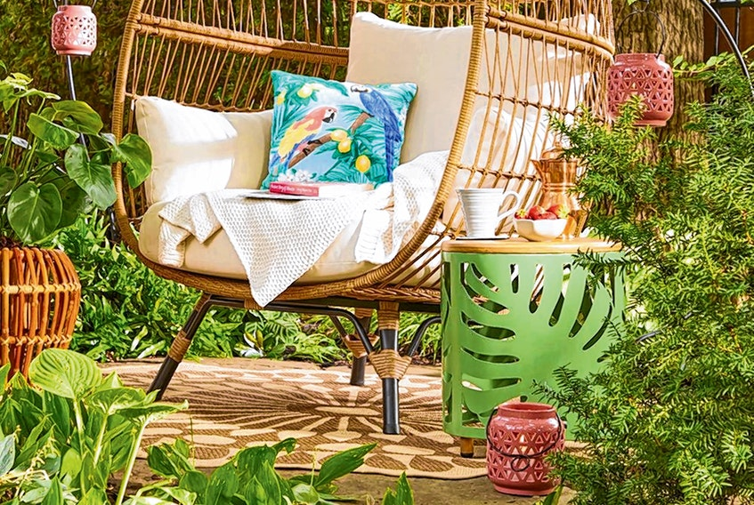 Natural elements mixed with bright, leafy colours help create a tropical vibe for the patio. Hampton Bay green garden side table, $99, HomeDepot.ca.