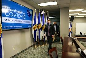 Nova Scotia Premier Iain Rankin and Dr. Robert Strang, Nova Scotia's chief medical officer of health, enter the room ahead of their COVID-19 briefing Thursday, April 29, 2021.