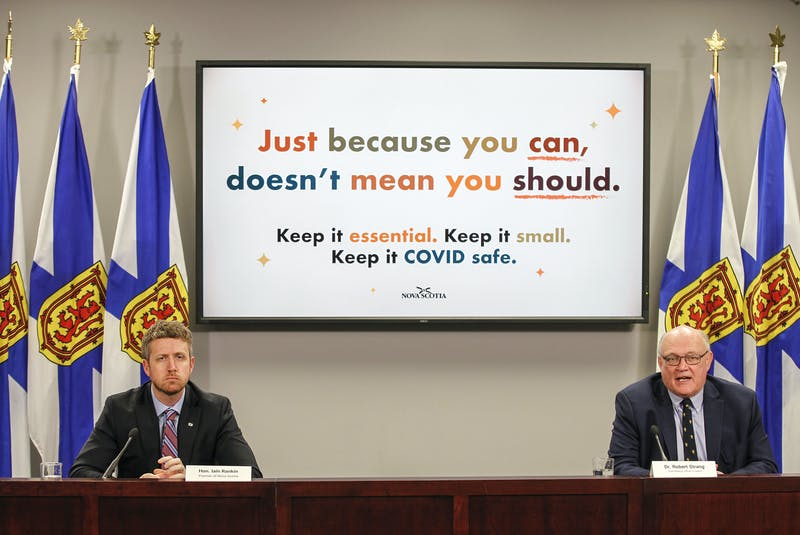 Premier Iain Rankin listens as Dr. Robert Strang, Nova Scotia's chief medical officer of health, talks during their COVID-19 briefing Thursday, April, 29, 2021. - Communications Nova Scotia