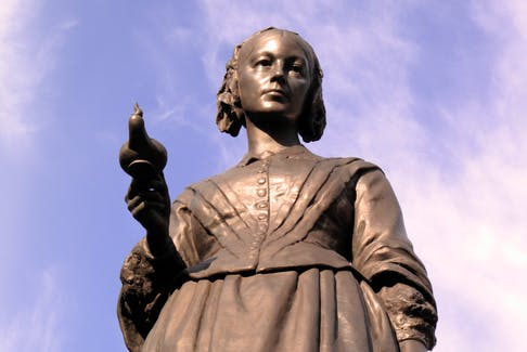 """A statue in London in memory of Florence Nightingale (1820-1910), who was an English nurse known as """"the lady with the lamp,"""" who cared for wounded soldiers in the Crimean War. Nursing week, which celebrates nurses each year, is marked in May as it aligns with Nightingale's birthday."""