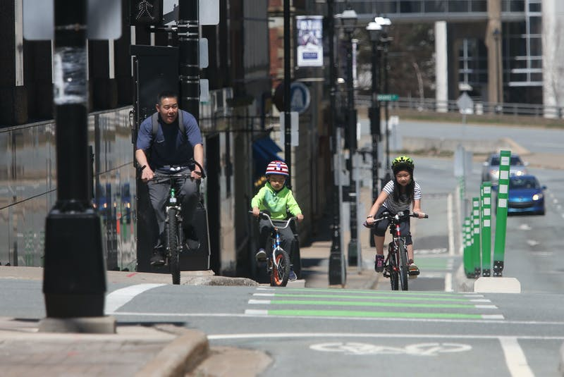 A man cycles with his children on Hollis Street in Halifax on the first day of the provincewide lockdown Wednesday, April 28, 2021. - Tim Krochak