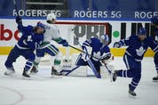 Vancouver Canucks Brock Boeser LW (6) watches the puck get past Toronto Maple Leafs David Rittich G (33) on a power-play goal by teammate J.T. Miller during the second period in Toronto on Thursday April 29, 2021. Jack Boland/Toronto Sun/Postmedia Network