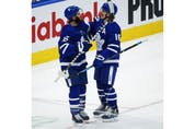 Toronto Maple Leafs Mitch Marner RW (16) scores after capitalizing on Vancouver Canucks Braden Holtby G (49) giveaway with teammate TAlexander Kerfoot C (15) during the third period in Toronto on Thursday April 29, 2021. Jack Boland/Toronto Sun/Postmedia Network