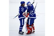Toronto Maple Leafs David Rittich G (33) is congratulated by teammate Mitch Marner after winning the game in Toronto on Thursday April 29, 2021. Jack Boland/Toronto Sun/Postmedia Network
