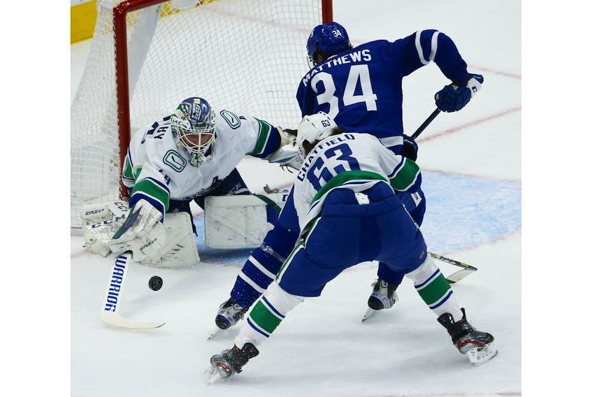 Vancouver Canucks Braden Holtby G (49) poke checks Toronto Maple Leafs Auston Matthews C (34) as he comes in to try and score during the first period in Toronto on Thursday April 29, 2021. Jack Boland/Toronto Sun/Postmedia Network