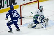 Toronto Maple Leafs William Nylander RW (88) beats Vancouver Canucks Braden Holtby G (49) to the far side corner during the first period in Toronto on Thursday April 29, 2021. Jack Boland/Toronto Sun/Postmedia Network