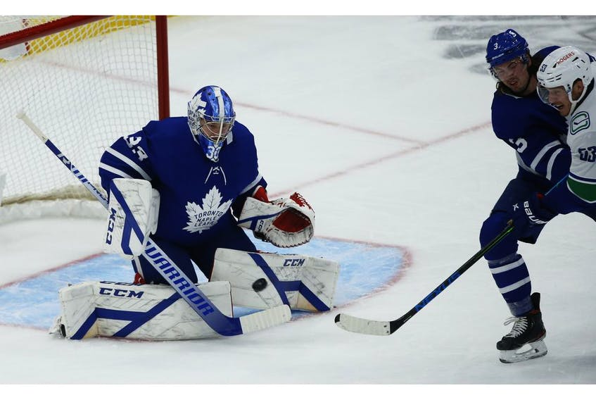 Toronto Maple Leafs David Rittich G (33) keeps his eye on the incoming shot during the second period in Toronto on Thursday April 29, 2021. Jack Boland/Toronto Sun/Postmedia Network