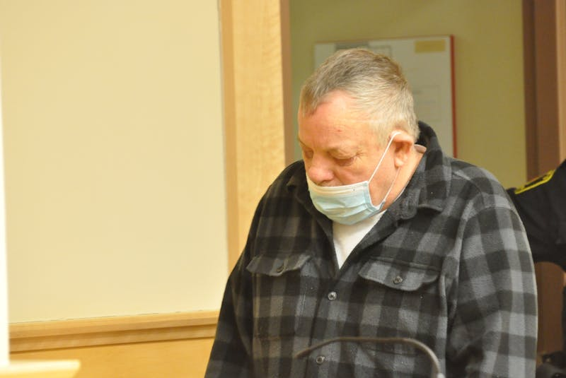 George Brake of Bonne Bay makes his way into a courtroom in provincial court in Corner Brook on Friday. — Diane Crocker