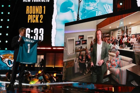 NFL commissioner Roger Goodell announces the Jacksonville Jaguars' selection of quarterback Trevor Lawrence with the first pick of the 2021 NFL draft at the Great Lakes Science Center in Cleveland, Ohio, last night. Getty Images