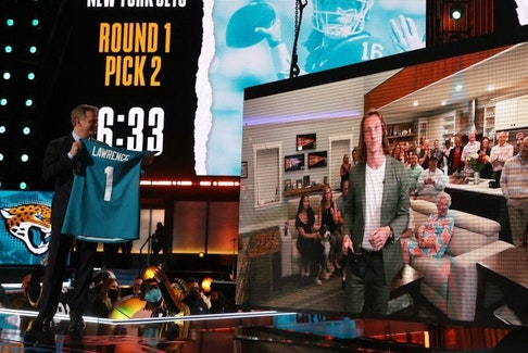 NFL commissioner Roger Goodell announces the Jacksonville Jaguars' selection of quarterback Trevor Lawrence with the first pick of the 2021 NFL draft at the Great Lakes Science Center in Cleveland, Ohio, last night.Getty Images