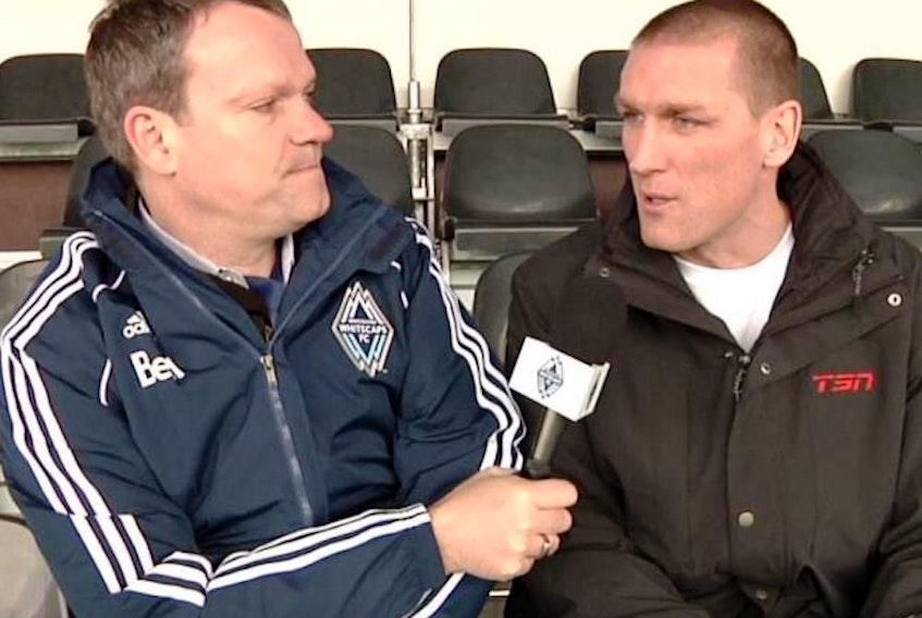 Peter Schaad talks with former Canadian international Jason DeVos.