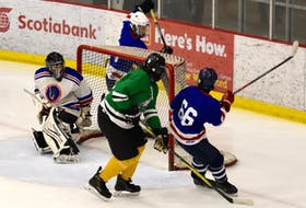 Two Eskasoni teams playing a midget semifinal match during the 46th annual Wallace Bernard Memorial Hockey Tournament at the Membertou Sport and Wellness Centre in 2019. Pictured are goaltender Clifford Cremo and players Jacob Denny, Stan Paul and Brett Denny. DAVID JALA/CAPE BRETON POST