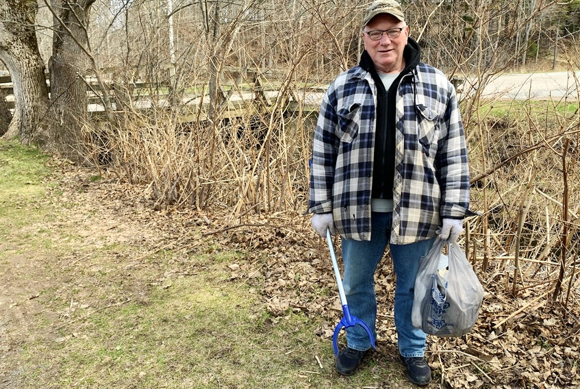 Walter Fortune walks in Victoria Park every day with a garbage picker in hand. Fortune likes to pitch in and help keep the area clean. JOEY SMITH
