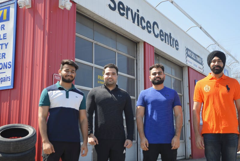 Meet the young guns whose latest Cape Breton business venture is in the automotive sector. The quartet of 20-somethings recently purchased a prime Prince Street property in Sydney that they plan to re-open as a vehicle service centre that will include oil changes, alignments and a small used car lot. From left: Ankit Balyan, Sanjeev Yadav, Ajay Balyan and Lovepreet Singh. DAVID JALA/CAPE BRETON POST - David Jala
