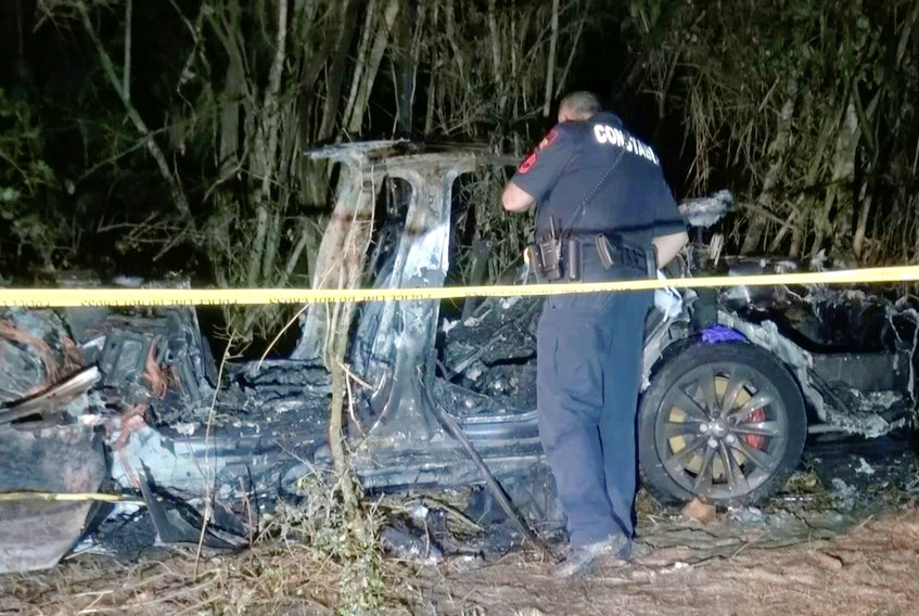 The remains of a Tesla vehicle are seen after it crashed in The Woodlands, Texas on April 17, in this still image from video obtained via social media. SCOTT J. ENGLE via REUTERS File Photo