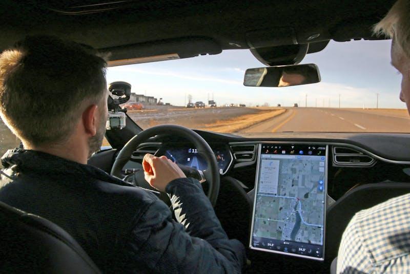 Calgary Herald writer Tom Babin lets the Autopilot drive the Tesla Model S P90D electric car east of Calgary. Postmedia News files - POSTMEDIA