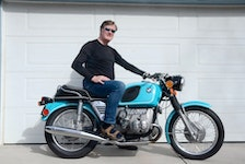 Calgary motorcycle enthusiast Gord McLellan with his finished 1973 BMW R75/5 — a machine he found offered for free on Kijiji. After cautiously adding several hundred kilometres to the bike since completing the project, he's confident the machine will carry him anywhere he'd like to tour. Photo courtesy of Gord and Krista McLellan