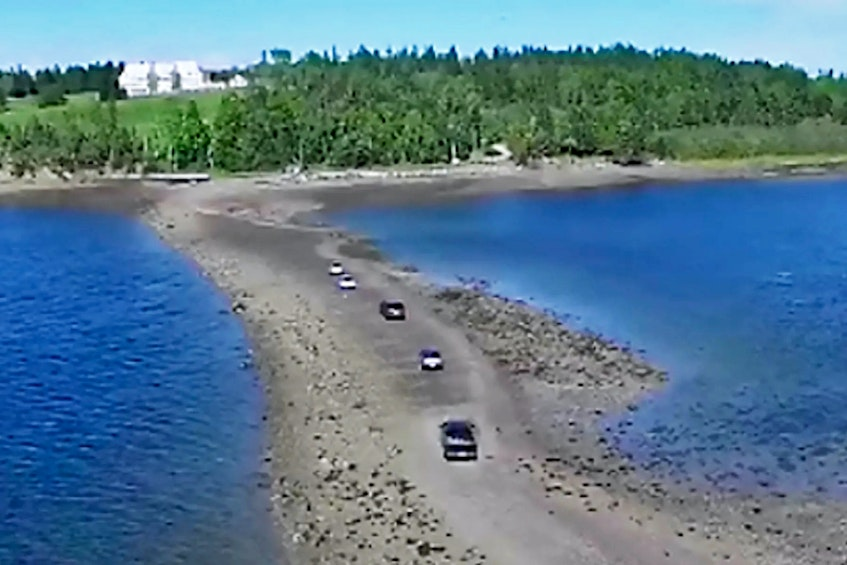 At low tide, one can walk or drive across a wide gravel bar to access Minister's Island in New Brunswick. Photo courtesy of ministersisland.net - POSTMEDIA