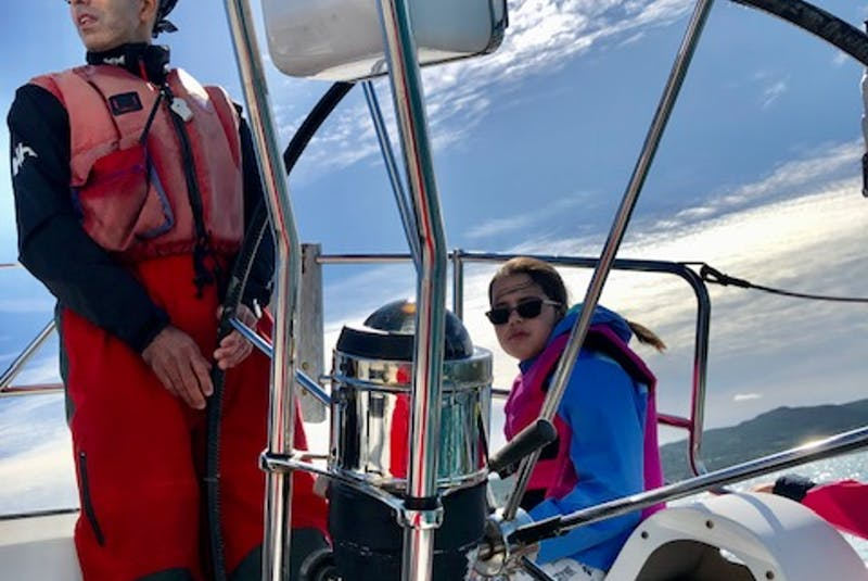 Justin Ladha enjoys a ride on his family's sailboat Shalloway alongside his eldest daughter, Maddy. — Contributed - Contributed