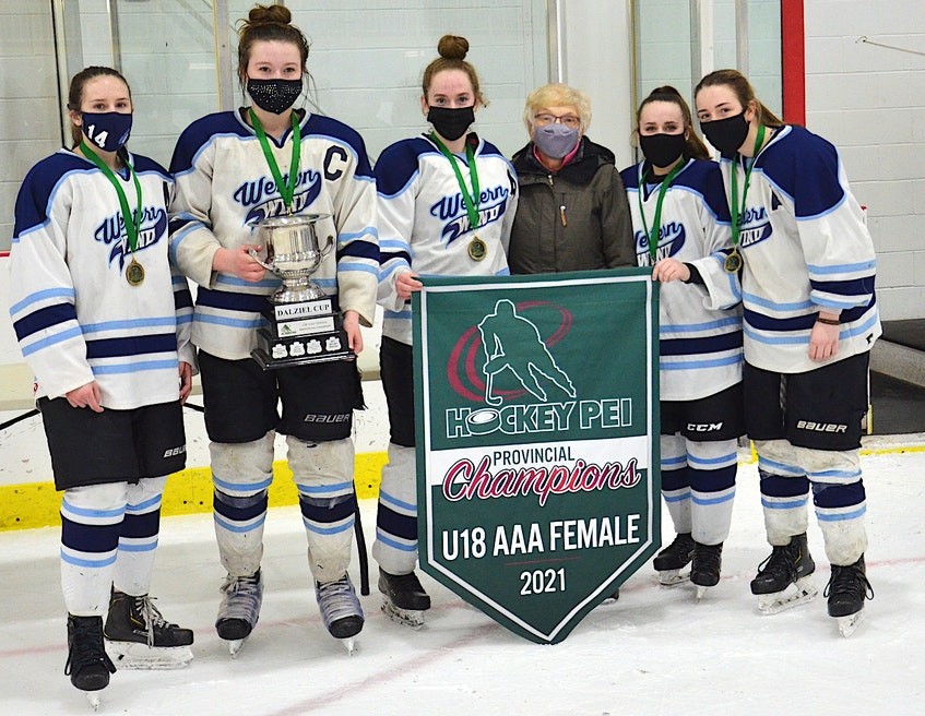 Susan Dalziel, third from right, presented the Dalziel Cup and the P.E.I. Under-18 AAA Girls Hockey League championship banner to the Western Wind on Saturday night. From left are assistant captain Gracie Hackett, captain Kylie Campbell, assistant captain Emma Dyer, Dalziel, assistant captain Macy Hackett and assistant captain Tianna Gallant. Dalziel is a longtime promoter and supporter of female hockey on P.E.I. - Jason Simmonds