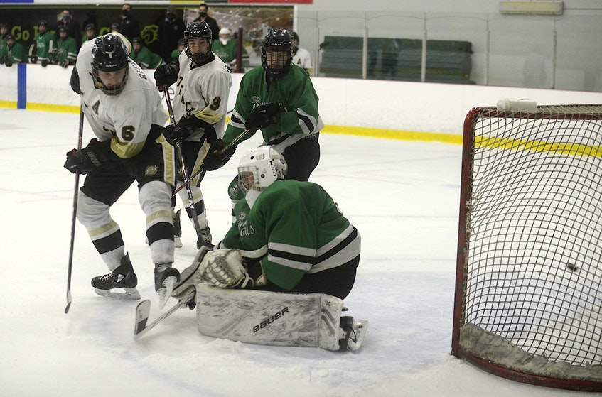 Sherwood Drug Mart Central Attack forward Nik Reeves, left, provided the screen on the tying goal with 31 seconds remaining in the third period of Saturday's game. - Jason Malloy