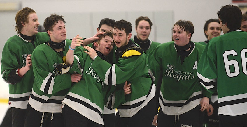 Rankin Noye, third from left, is congratulated by his Western Regals teammates after scoring the overtime goal to clinch the P.E.I. under-18 AAA hockey title. - Jason Malloy