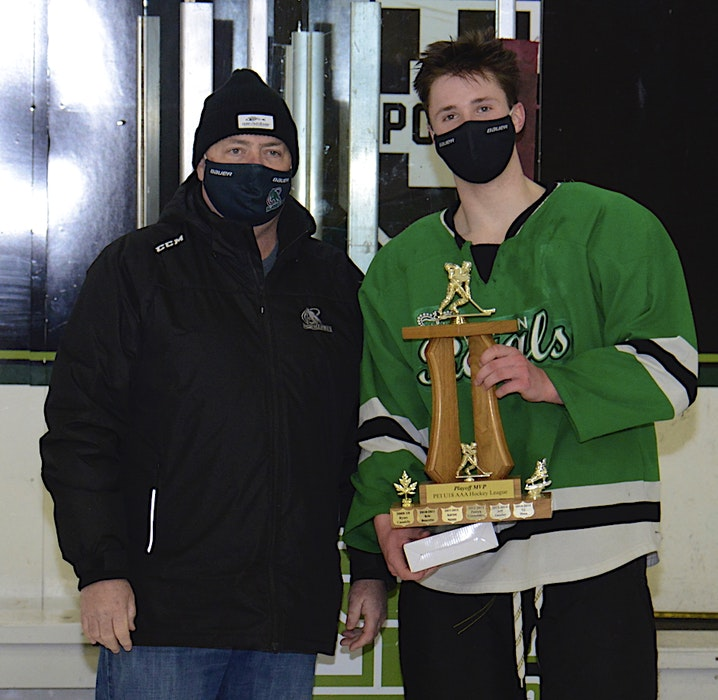 Hockey P.E.I.'s Robert MacMillan, left, presents Marshall Gallant with the playoff MVP trophy for the P.E.I. Under-18 AAA Hockey League. - Jason Malloy