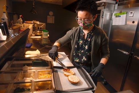 Jennifer Kwan makes a breakfast sandwich at her Goodfare Halifax cafe and takeout restaurant on Monday. Goodfare opened in December on Walter Havill Drive in the Armdale neighbourhood. Ryan Taplin - The Chronicle Herald