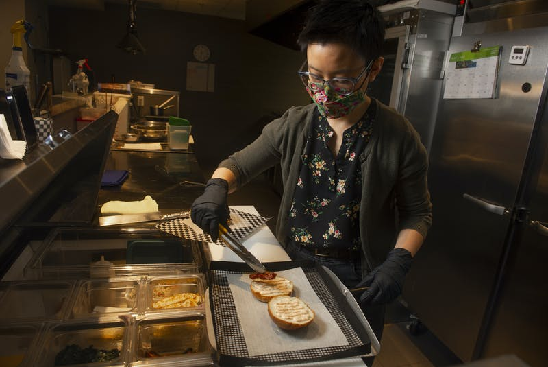 Jennifer Kwan makes a breakfast sandwich at her Goodfare Halifax cafe and takeout restaurant on Monday. Goodfare opened in December on Walter Havill Drive in the Armdale neighbourhood. - Ryan Taplin