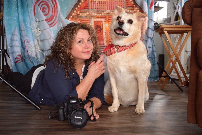 Shauna Madden, owner of Shauna Madden Photography, with her mix breed Isla she adopted from the Cape Breton SPCA as a puppy. Madden, who suffers from depression, said she found happiness leaving a long-time career for her passion and opened Shauna Madden Photography in October 2020. Sharon Montgomery-Dupe/Cape Breton Post
