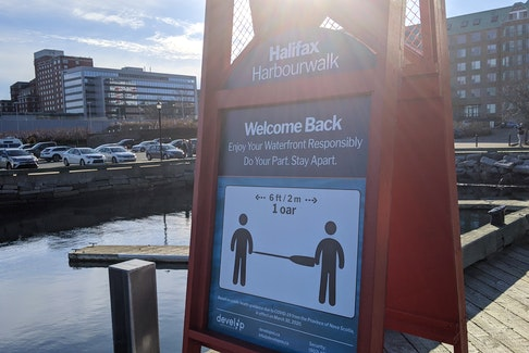 A sign on the Halifax waterfront promotes social distancing amid the COVID-19 pandemic. - File