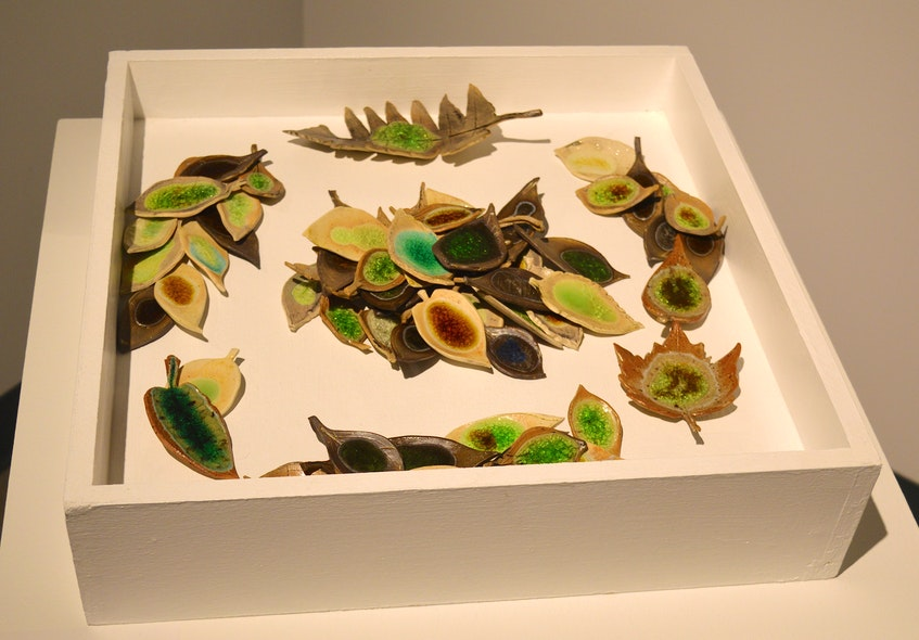 "Leaves made from stoneware and porcelain clay and beach glass are strewn about as part of artist Marla Benton's entry in the Ground Rules: The Before and After exhibit. ""Brought together in the forest, we artists gathered and fell into place. Each unique in markings and colours, with our own experiences, and yet sharing am experience together,"" she writes in her description. Chris Connors • Cape Breton Post - Christopher Connors"